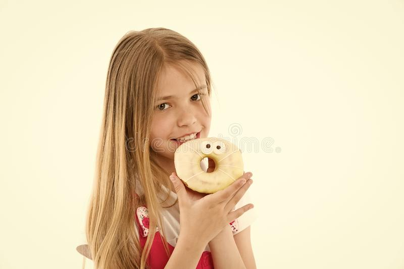 Child eat donut isolated on white. Little girl with glazed ring doughnut. Kid with junk food. Food for snack and dessert royalty free stock images