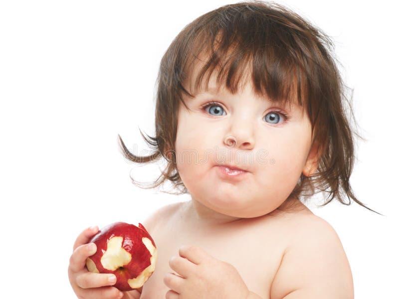 Child eating apple royalty free stock image