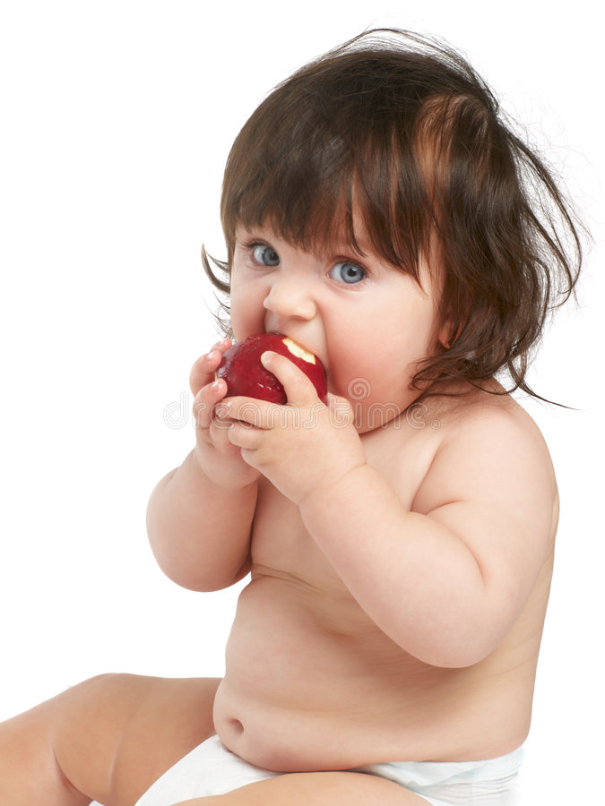 Child eating apple royalty free stock photo