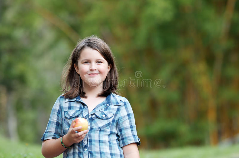 Child eating apple royalty free stock photography