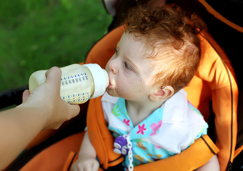 Download Child eating from bottle stock photo. Image of little - 19750274