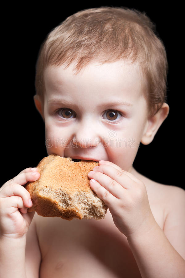 Download Child eating bread stock photo. Image of issue, despair - 16776328