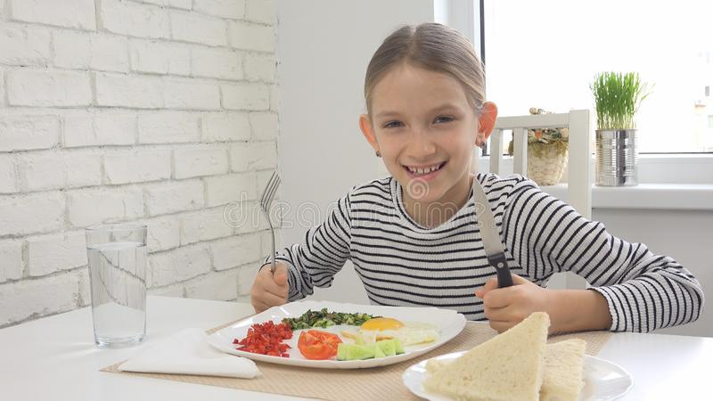 Child Eating Breakfast in Kitchen, Kid Eats Healthy Food Eggs, Girl Vegetables stock photos