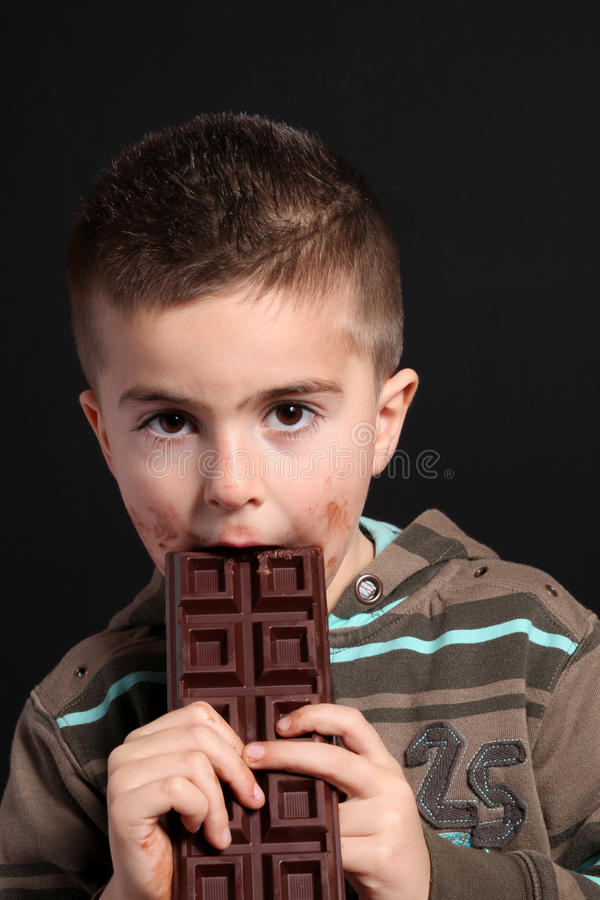 Child eating a chocolate bar