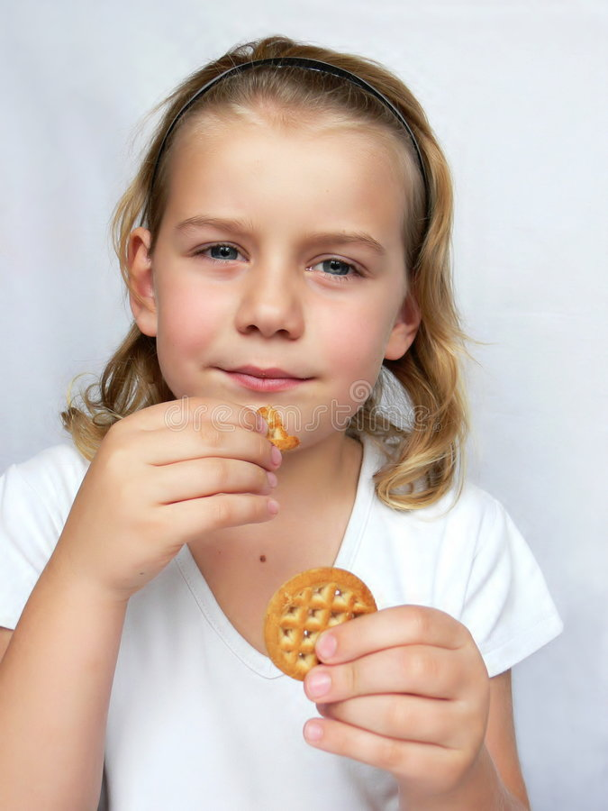 Download Child is eating cookies stock photo. Image of food, girls - 3729324