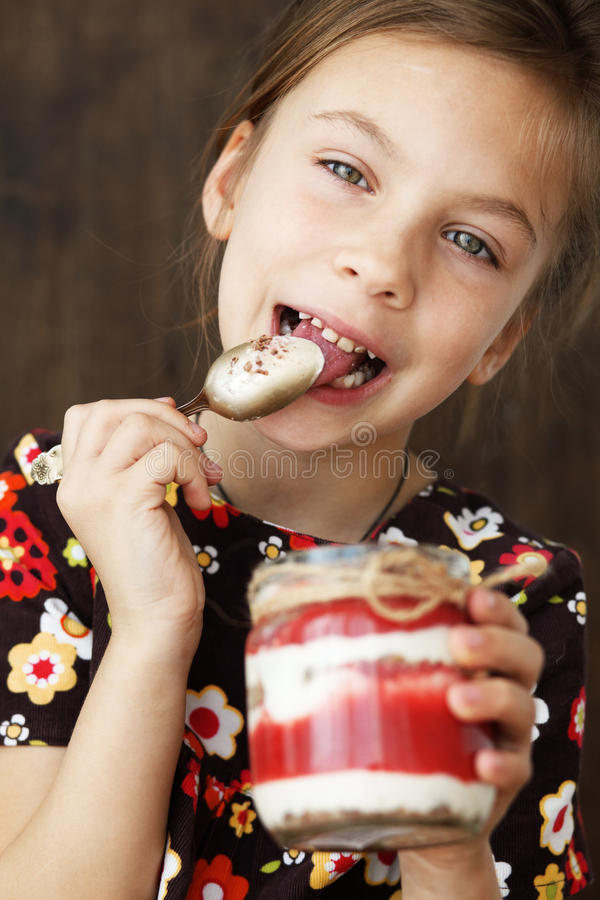 Download Child eating dessert stock image. Image of life, face - 31997481