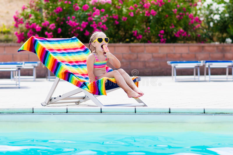 Child eating ice cream at swimming pool royalty free stock photos