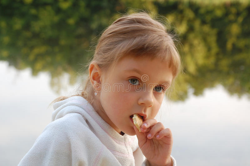 Child eating outdoor royalty free stock images