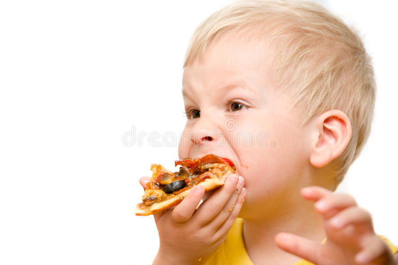 Child eating pizza stock photos