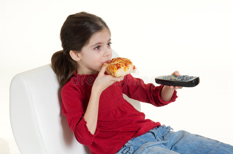 Child eating pizza stock photography