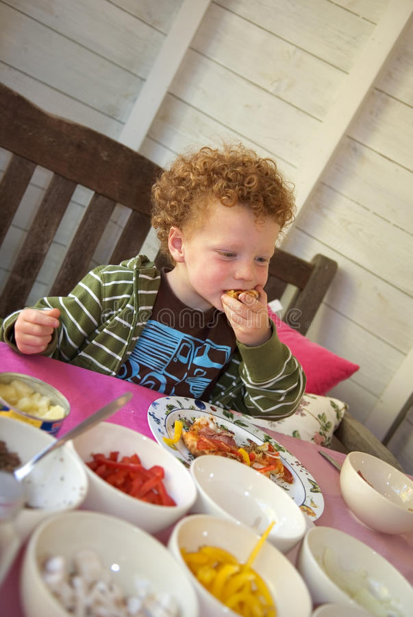 Download Child eating Pizza stock image. Image of caucasian, curly - 9572009
