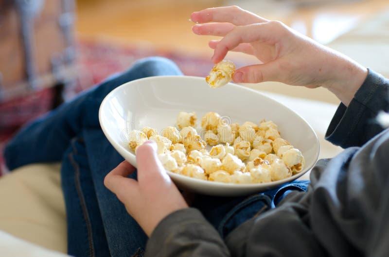 Child eating popcorn royalty free stock photo