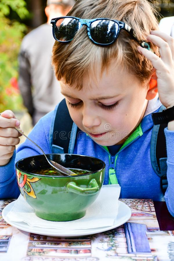 Child eating a soup stock photo