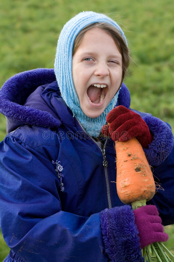 Child Eating Vegetable. Stock Images