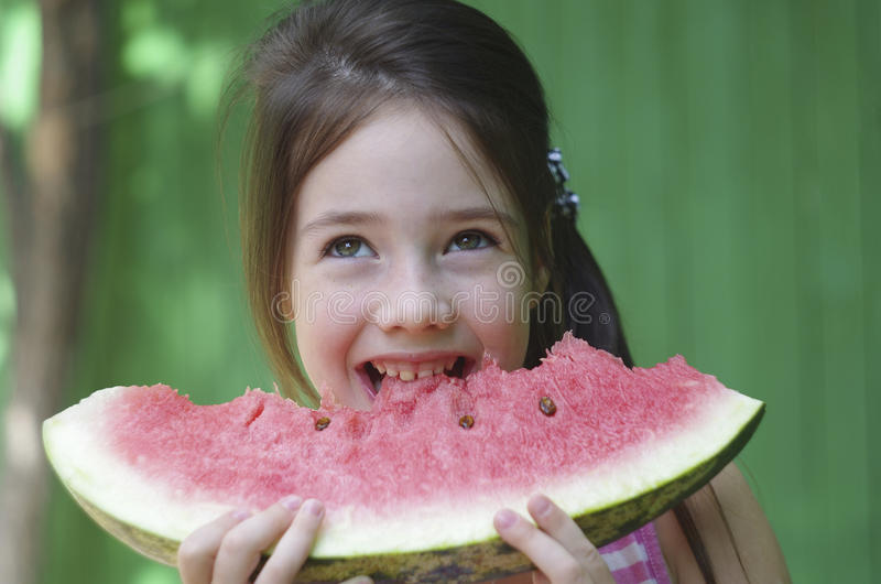 Child eats watermelon stock photos
