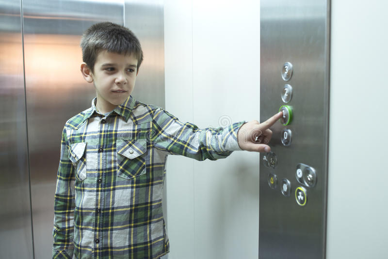Child in an elevator stock photography