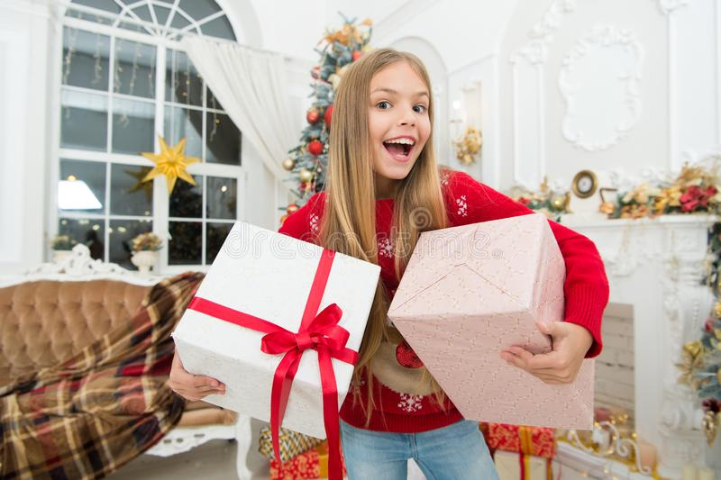 Child enjoy the holiday. Christmas tree and presents. Happy new year. The whole world in one touch. Winter. xmas online stock image