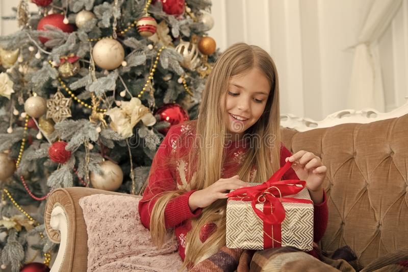 Child enjoy the holiday. Christmas tree and presents. Happy new year. Winter. xmas online shopping. Family holiday. The. Morning before Xmas. Little girl. Thank royalty free stock photo