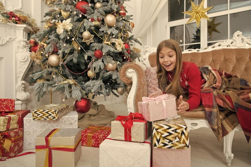 Child enjoy the holiday. By golly, be jolly. Happy new year. Winter. xmas online shopping. Family holiday. Christmas. Tree and presents. The morning before Xmas stock image