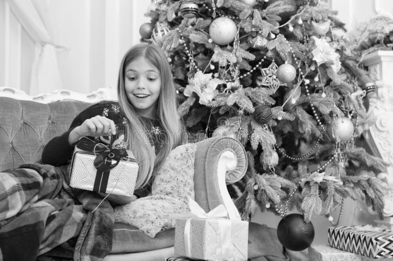 Child enjoy the holiday. Happy new year. Winter. xmas online shopping. Family holiday. Christmas tree and presents. Capturing a happy moment. The morning royalty free stock photos