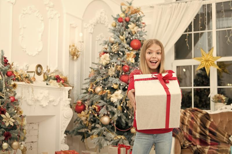 Child enjoy the holiday. Happy new year. Winter. xmas online shopping. Family holiday. Christmas tree and presents. The. Morning before Xmas. Little girl. Magic stock image