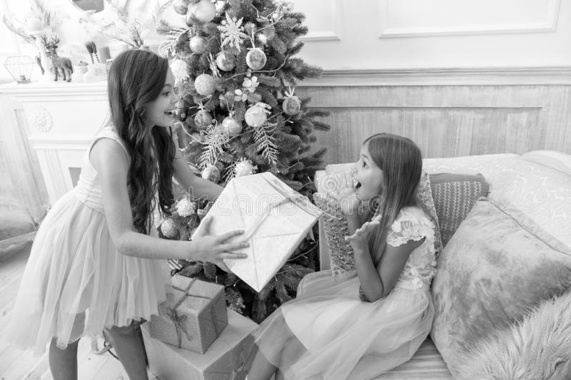 Child enjoy the holiday. The morning before Xmas. Little girls. Christmas tree and presents. Happy new year. Winter. Xmas online shopping. Family holiday. So stock photos