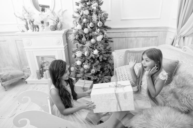 Child enjoy the holiday. The morning before Xmas. Little girls. Christmas tree and presents. Happy new year. Winter. Xmas online shopping. Family holiday stock photography