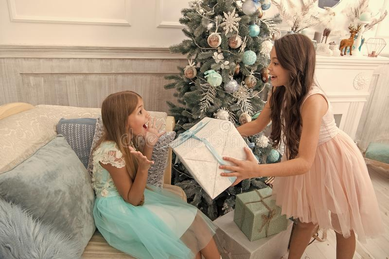 Child enjoy the holiday. The morning before Xmas. Little girls. Christmas tree and presents. Happy new year. Winter. Xmas online shopping. Family holiday. So royalty free stock image