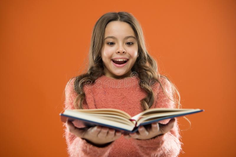 Child enjoy reading book. Book store concept. Wonderful free childrens books available to read. Childrens literature. Reading activities for kids. Girl hold royalty free stock image