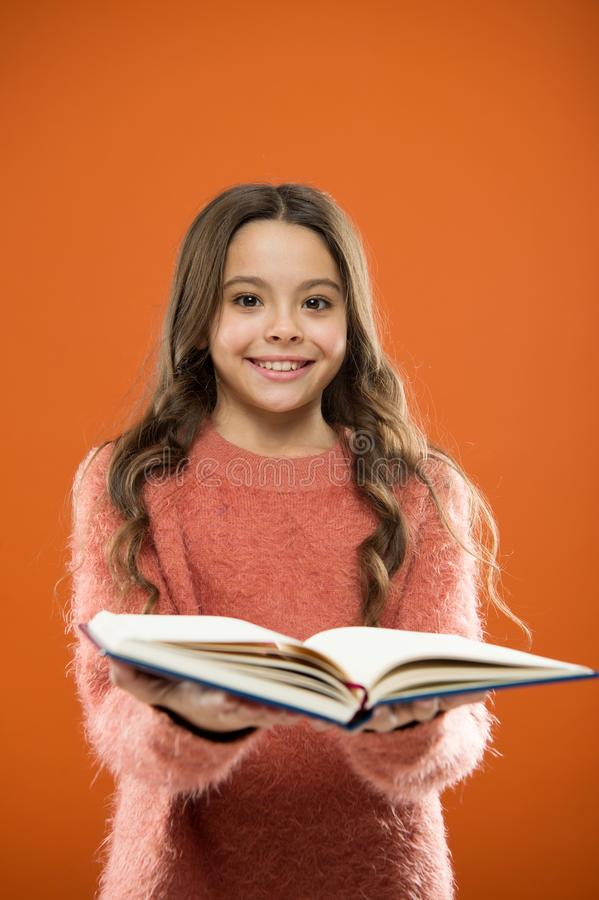 Child enjoy reading book. Book store concept. Wonderful free childrens books available to read. Reading practice for. Kids. Childrens literature. Girl hold book royalty free stock photography