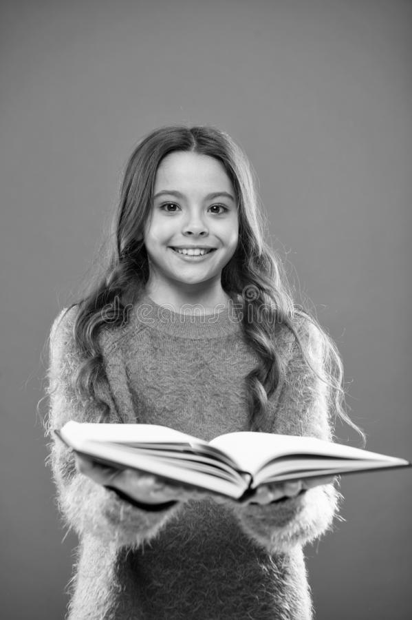 Child enjoy reading book. Book store concept. Wonderful free childrens books available to read. Reading practice for. Kids. Childrens literature. Girl hold book royalty free stock photo