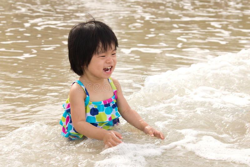 Download Child enjoy waves on beach stock photo. Image of girl - 26096248