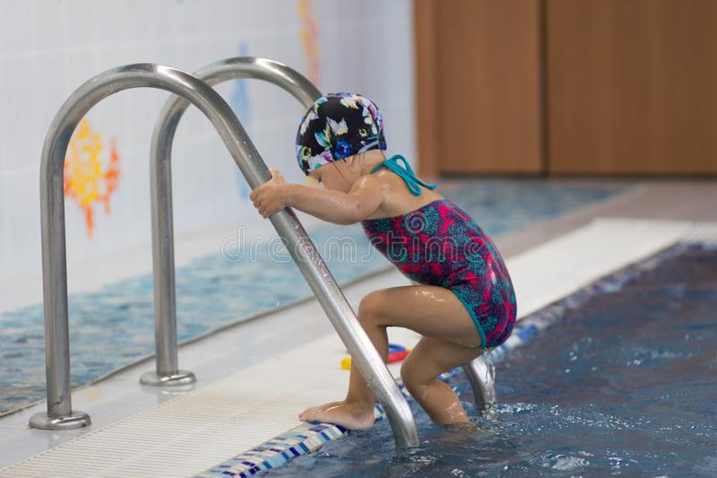 Child entering the swimming pool royalty free stock photo