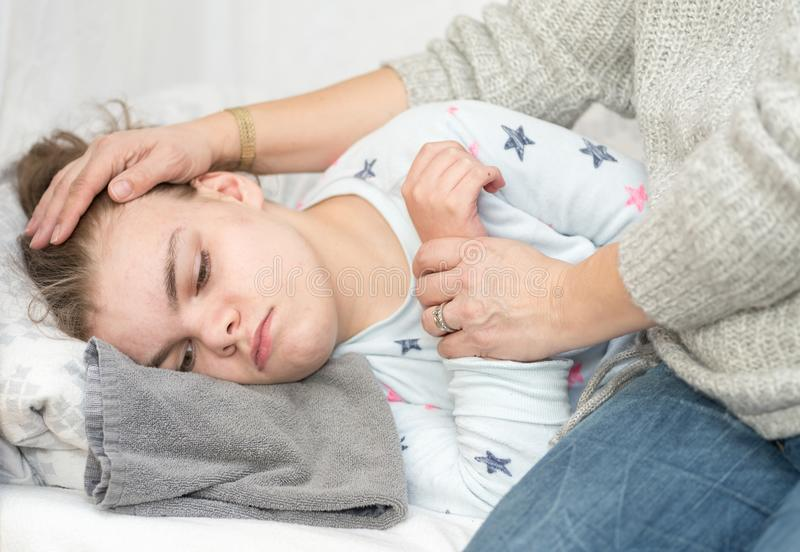 A child with epilepsy during a seizure stock images