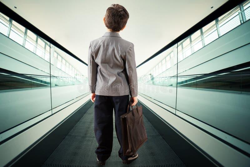 Child on escalator stock photos