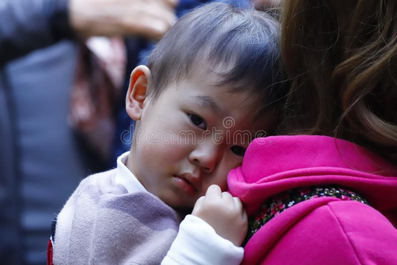 A child of an ethnic minority of Yunnan in the market of Zhoucheng village, Dali, Yunnan, China royalty free stock photos