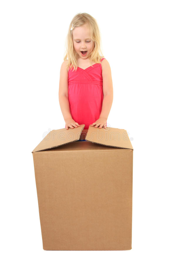 Download Child Excited While Opening Gift Stock Photo - Image: 15867850