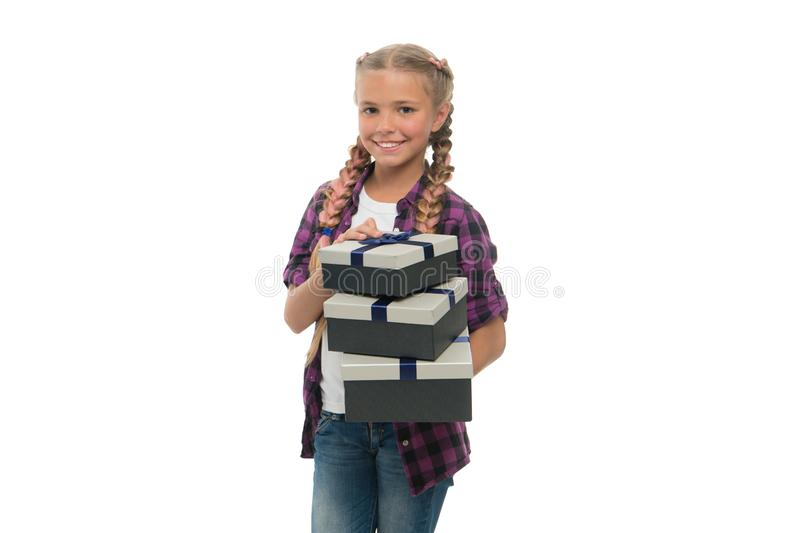 Child excited about unpacking gifts. Small girl received birthday gifts. Dreams come true. Best birthday and christmas. Gifts. Kid girl with braids hairstyle stock photography