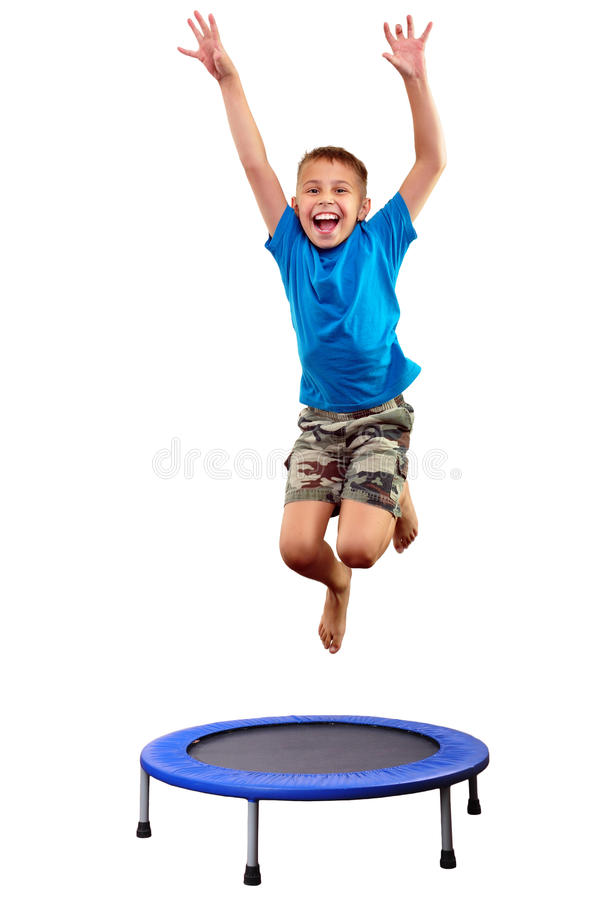 Child exercising and jumping on a trampoline. Portrait of a cute sportive, cheerful happy kid jumping and dancing on batut. Childhood, freedom, happiness concept royalty free stock image