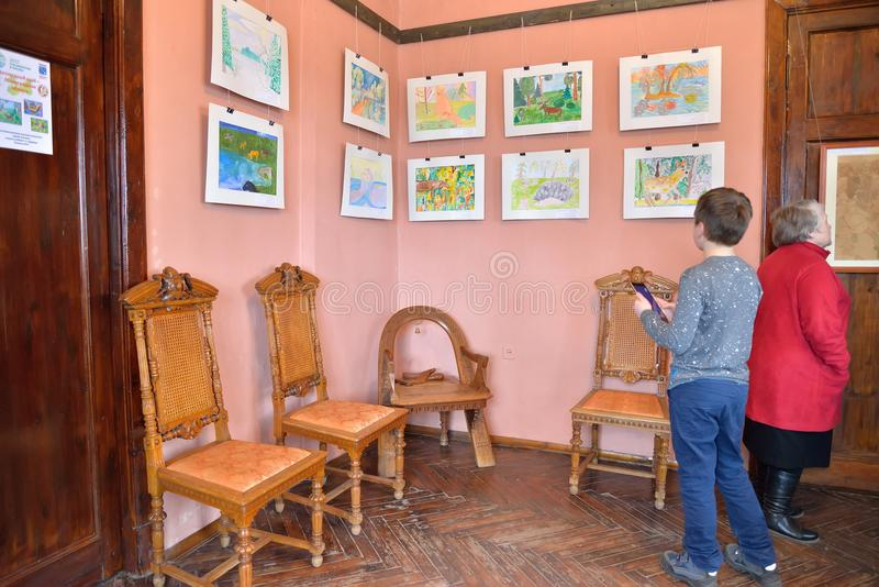 The child at the exhibition of children's drawings in the Museum. ST.PETERSBURG, RUSSIA - MARCH 03, 2017: The child at the exhibition of children's drawings in stock images