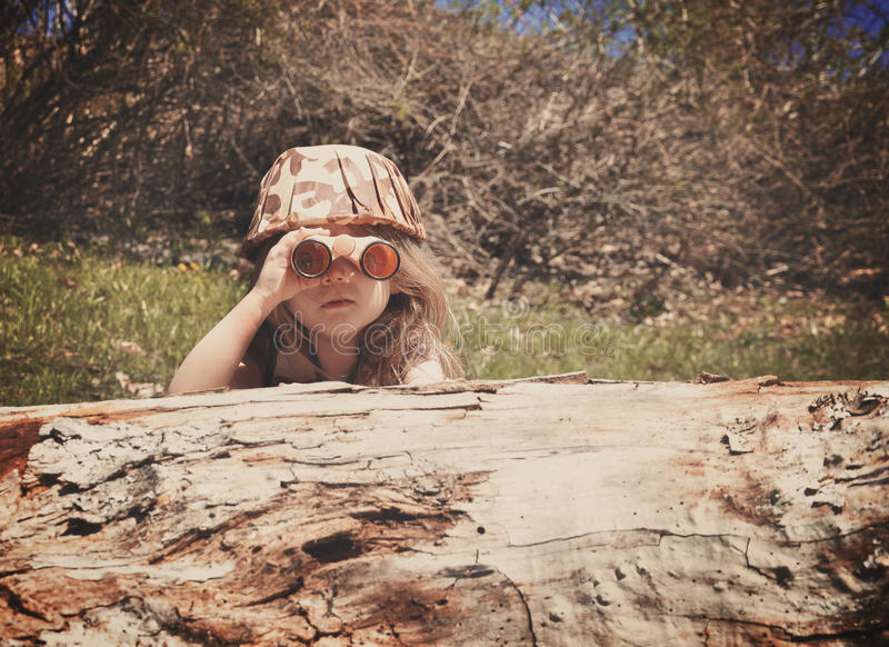 Child Exploring in Woods stock photo