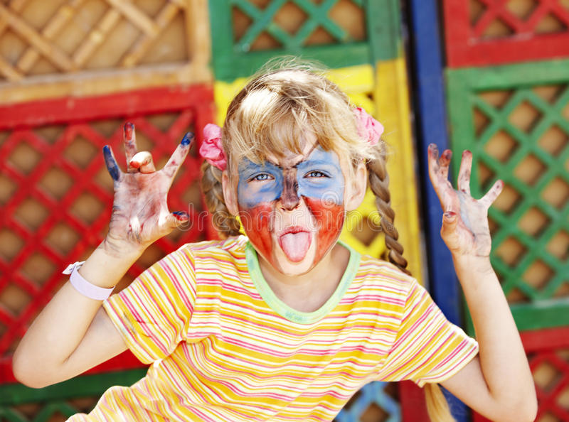 Child with face painting. royalty free stock photo