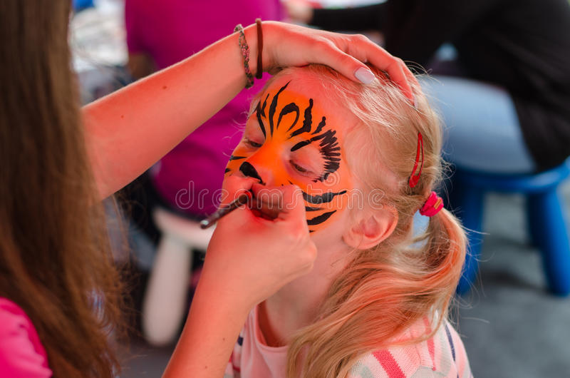 Child with face painting royalty free stock photo