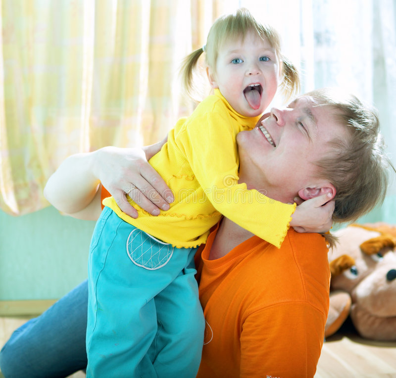 Child with father. At home stock photos