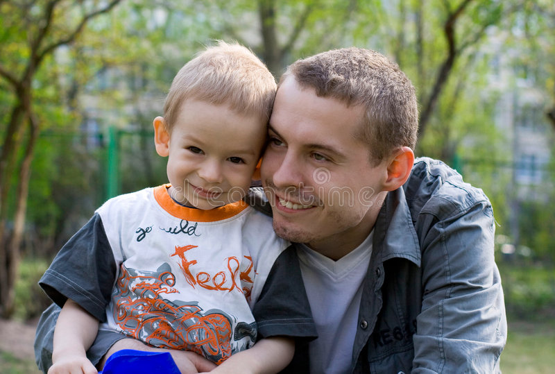 Child and father. In park stock image
