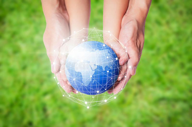 Child and father holding planet Earth in hands against green spring background. Child and father holding planet Earth in hands against green spring background stock images