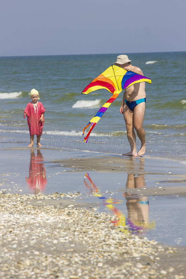 Child and father at the sea side royalty free stock image