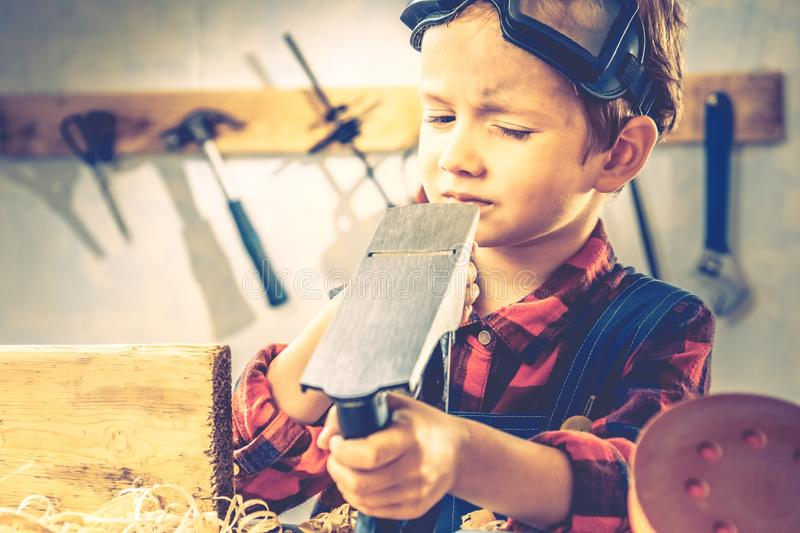 Child fathers day concept, carpenter tool,  kid board royalty free stock images