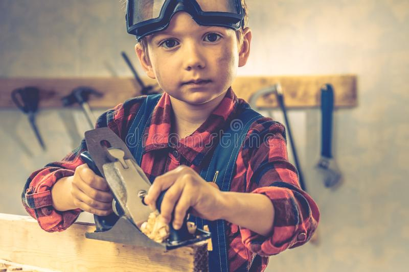 Child fathers day concept, carpenter tool,  person craft stock photography