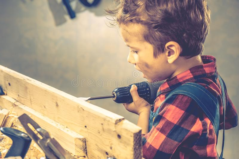 Child fathers day concept, carpenter tool,  person workshop royalty free stock photography